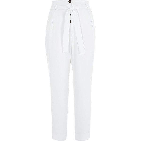 River Island White button front tapered peg pants (€61) ❤ liked on Polyvore featuring pants, tapered trousers, white, women, tapered fit pants, tapered leg pants, tie waist pants, tie waist trousers and woven pants
