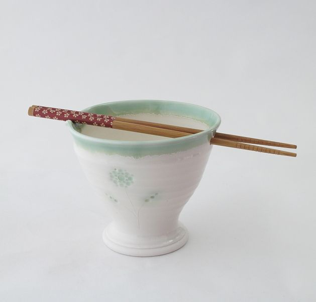 """Hand thrown porcelain bowl made from high quality """" Ming"""" porcelain glazed with clear porcelain and green reactive glaze. Microwave and dishwasher safe. http://www.marketdirect.ie/porcelain-noodle-bowl"""