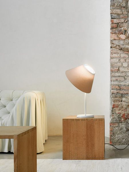 #Cappuccina table by Inga Sempé is a fixture composed of a slender metal base and a spherical luminous body in opaline glass, containing an LED module, on which the fabric shade simply rests, without attachment: this configuration makes it possible to move the shade and orient the light to meet different needs. http://www.luceplan.com/Prodotti/1/2/1117/Cappuccina