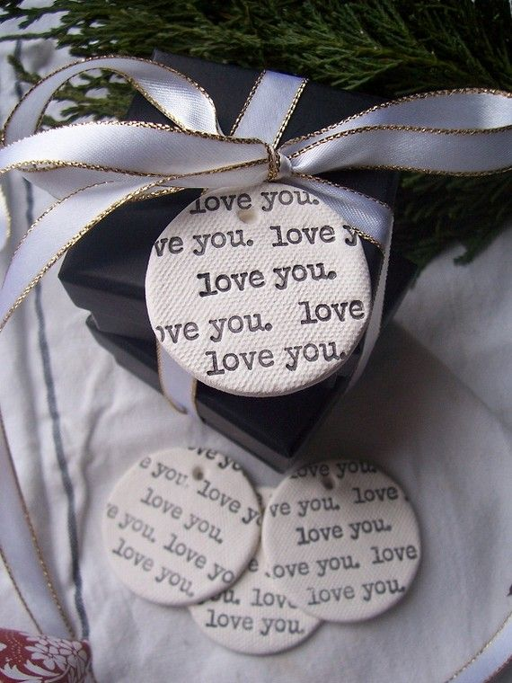 Gorgeous Clay Gift Tags from Etsy but I could do this with heavy paper, my typewriter, and a circle punch