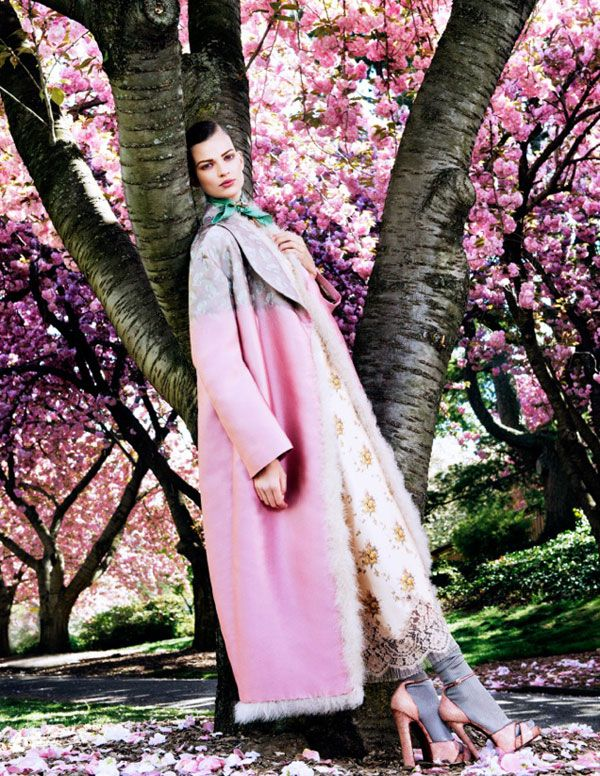 Posing in Pink – Photographed during the height of cherry blossom season at Brooklyn's Botanical Garden, Bette Franke is pretty in pastels for the August edition of Vogue Japan. The Dutch model poses for Sharif Hamza in vibrant looks from the likes of Rodarte, Miu Miu and Chanel selected by Giovanna Battaglia. A slicked back coif and soft makeup complement Bette's natural surroundings.