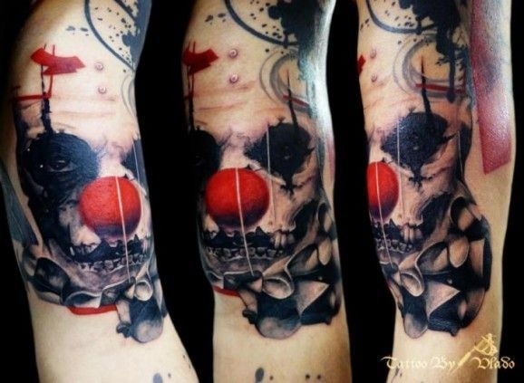 Spooky black clown with red nose tattoo