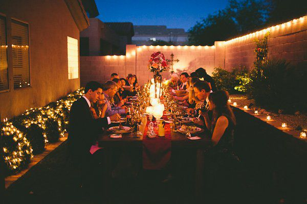 I like the idea of having a small rehearsal dinner set under the stars in the back yard.... so tranquil and low-key, but absolutely stunning.  Also, it's easier on the pocketbook