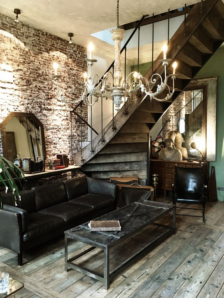 Interior, living room, edsign , vintage, chandelier, antique, old wooden floor boards, wrought iron coffee table, industrial atmosphere, leather retro sofa, old staircase
