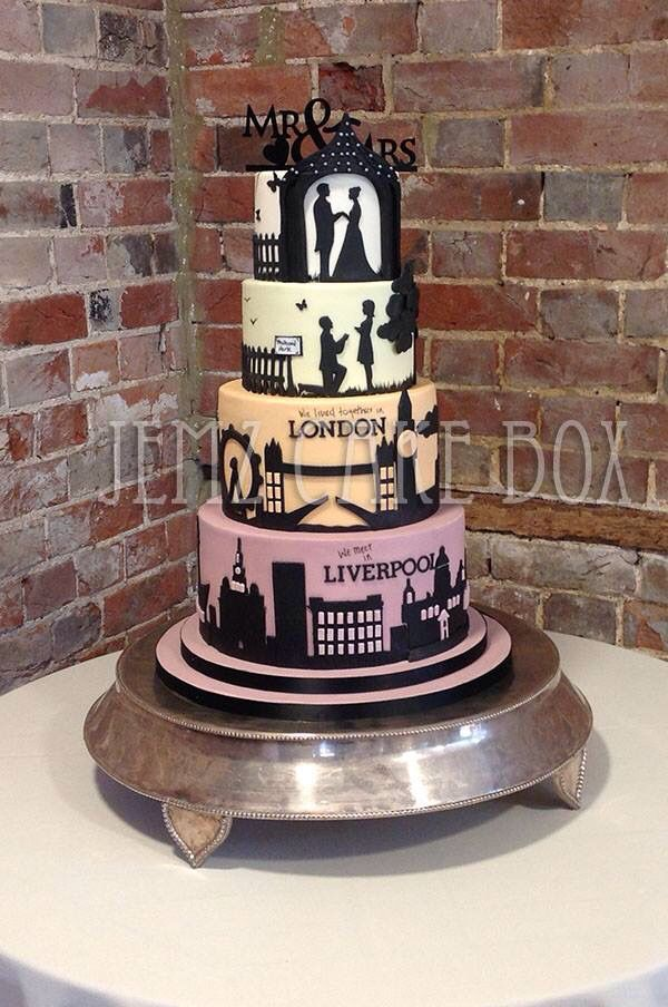 Silhouette wedding cake that tells a story of how the couple met, where they lived, wedding proposal and wedding day. Cake designed and made by Jemz Cake Box