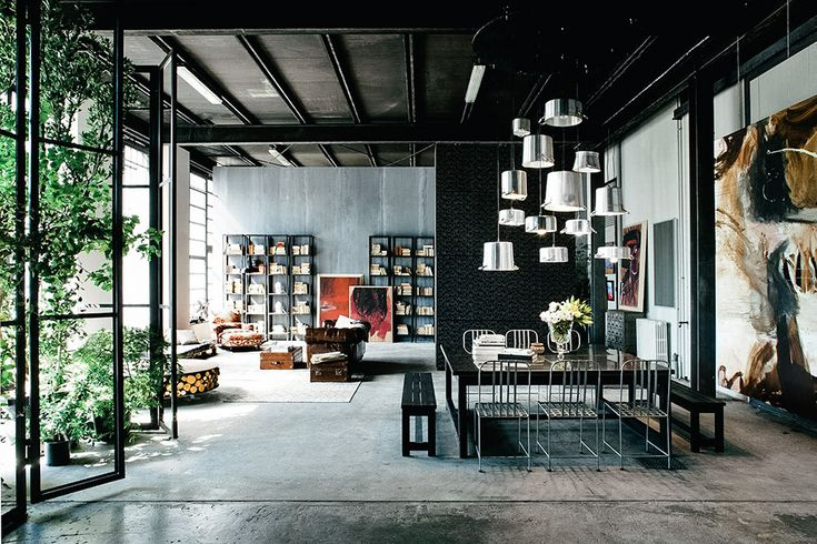 Filling a massive industrial space, this Milan Apartment uses intelligent small touches to make it feel more like a home and less like a former factory. Among those are cabinets in the kitchen clad in treated, unlaquered wood, outer columns...