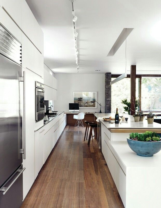 In photographer rob fioccas streamlined kitchen the islands varied levels and quartz countertop that appea