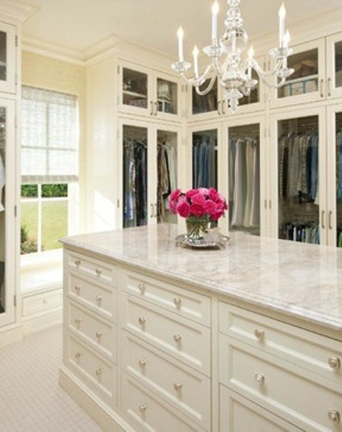 40 Pretty Feminine Walk-In Closet Design Ideas - I like the glass fronts to keep down on dust - would need the same units on the opposite wall with plenty of shoe and purse storage | DigsDigs