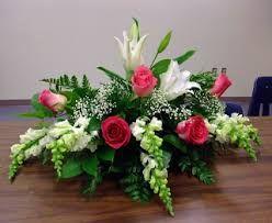 Risultati immagini per arranjos florais para igreja