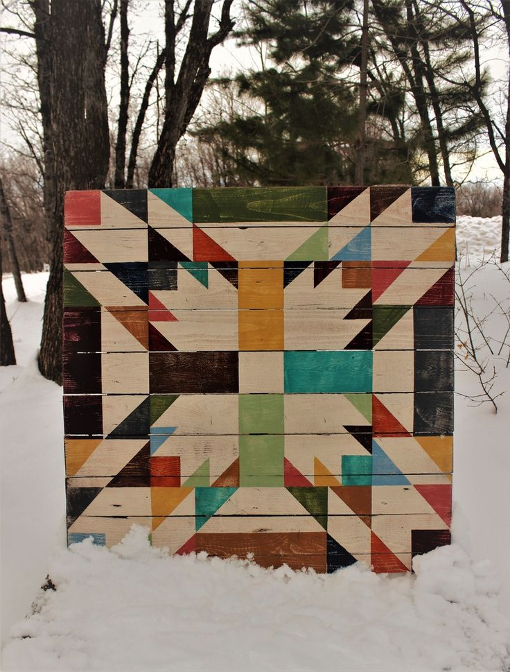This barn quilt is one of our all time favorites. It is a double bear paw quilt with color as the main focus. It truly looks like an old quilt. Han...