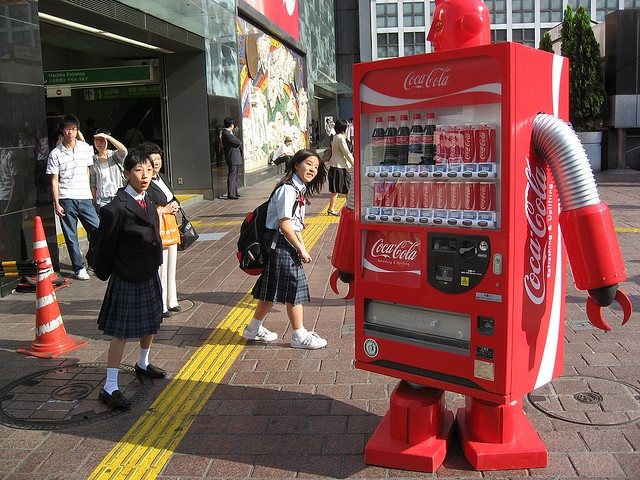 A Coke vending machine robot walking around outside of Shibuya Station in Tokyo - combining Robotics, Japanimation and Caffeination, the Coca-Cola vending machine robot is the perfect embodiment of all things geeky!