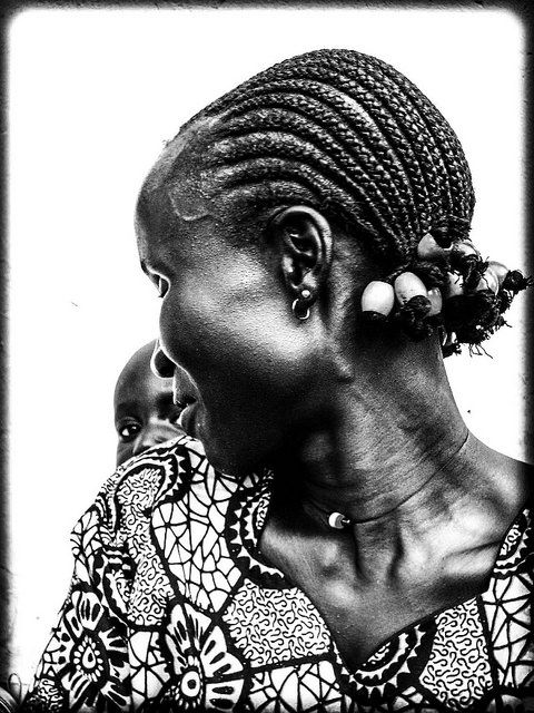 south sudanese woman with child uganda 2005