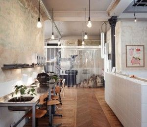 Café Coutume by Cut Architectures  Stripped wallpaper, tiles, plastic curtains