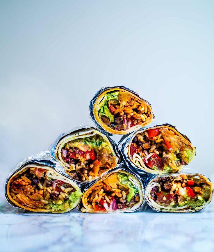 These epic vegan jackfruit burritos are filled with mexican rice, guacamole, refried black beans, pico de gallo and bbq jackfruit! Sumptuously satisfying!      #recipe #recipes #burrito #fajita #healthy #lunches #dinners #wrap #sauce #bean #freezer #filling #best #jackfruit #vegan #vegetarian #salsa