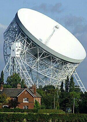 Jodrell Bank farmhouse dwarfed by the famous radio telescope