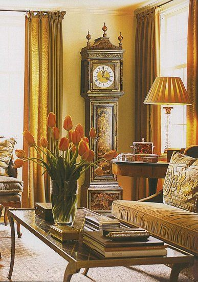 Love the draperies, wall color, clock, sofa, tables. Traditional perfection.