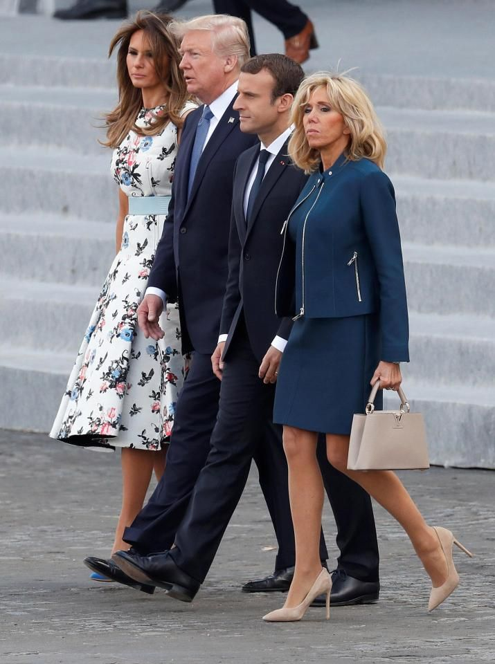 Macron and his wife Brigitte walk with Trump and Melania before they left the country on Air Force One