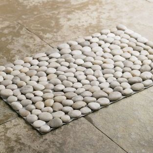 Cool find of the day - Black River Stone Mat - Made from river stones, this bathmat massages the feet, adding the natural element of rocks to the bathroom.