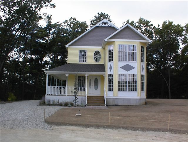 Two story home with victorian details and large wrap around porch excel homes custom modular Two story holiday homes