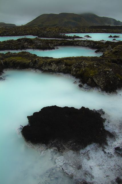 The Blue Lagoon (Bláa lónið) geothermal spa is one of the most visited attractions in Iceland. The steamy waters are part of a lava formation. The spa is located in a lava field in Grindavík on the Reykjanes Peninsula, southwestern Iceland.  By Sven Broeckx on flickr.