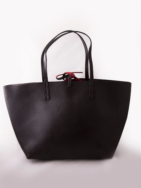 Go subtle with color with this Chocolate stylish Brown Serena Tote crafted in genuine leather by the Clique. This unique piece offers you a combination of the two with its gorgeous red interior designed with multiple compartments and zips to occupy your essential knick-knacks.