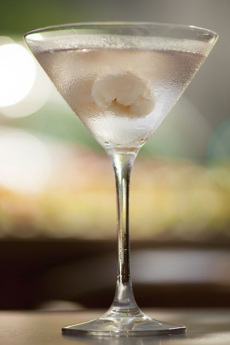 Lemon Grass & Lychee Martini. A delicious lemon grass and lychee martini, flavoured with Juniper berries and pomegrante.