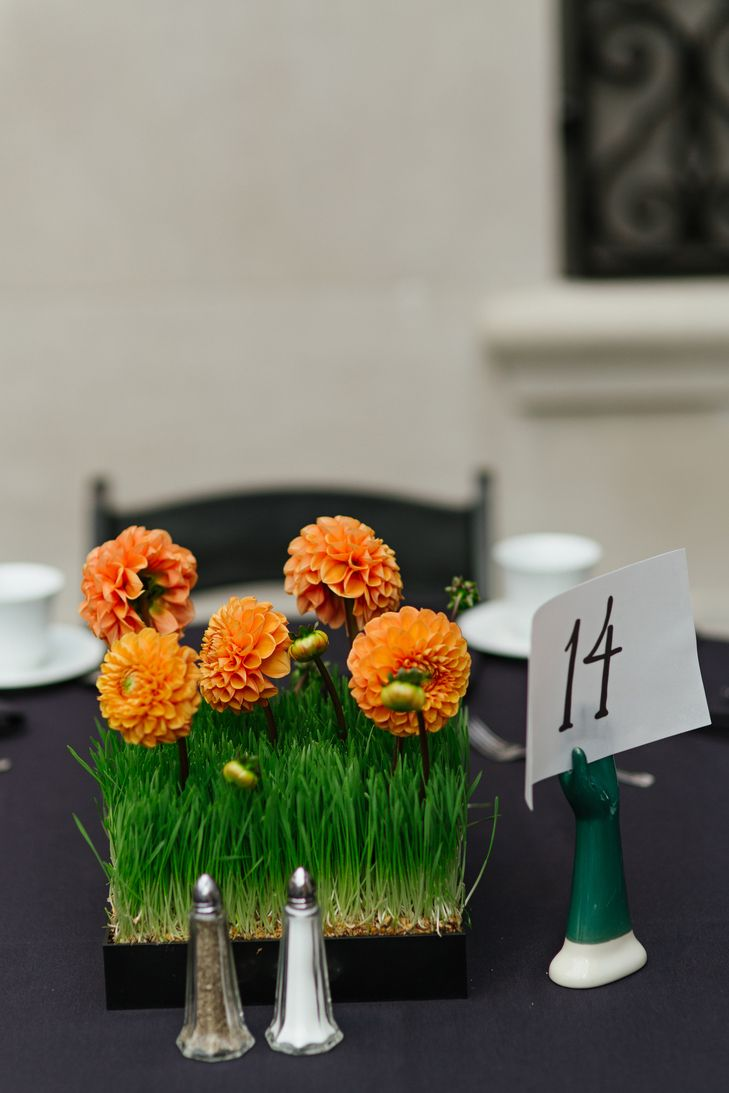Orange Dahlia and Wheat Grass Centerpieces | Photo: Jessica Miller Photography | Flowers: The Greenhouse |