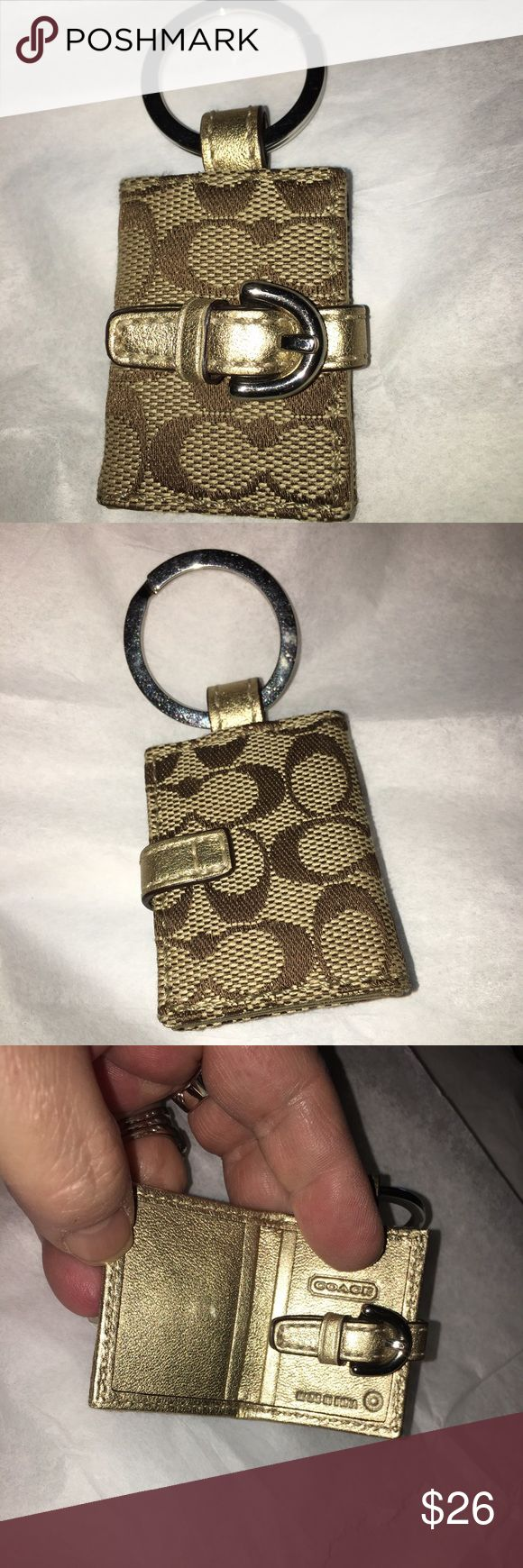 """NWOT Coach Magnetic Key Chain Brand New Coach Key Chain in Tan Signature Canvas opens up to a clear slip pocket for a pic, snaps closed and has silver hardware measures 3.5"""" in length Coach Accessories Key & Card Holders"""