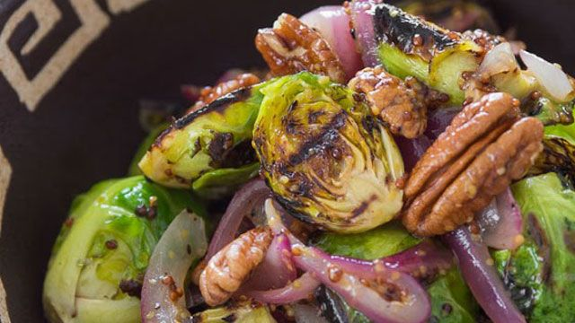 Serve this grilled Brussels sprouts recipe with a warm mustard dressing and caramelized onions for a side dish from PBS Food.