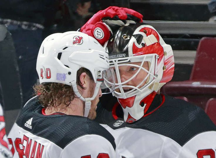 VANCOUVER, BC - NOVEMBER 1: Blake Coleman #40 of the New Jersey Devils congratulates teammate Cory Schneider #35 after their NHL game against the Vancouver Canucks at Rogers Arena November 1, 2017 in Vancouver, British Columbia, Canada. The New Jersey Devils won 2-1. (Photo by Jeff Vinnick/NHLI via Getty Images)