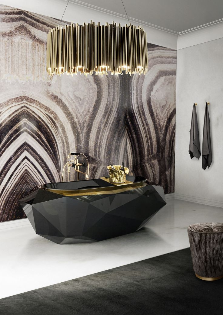 Create a luxurious bathroom with a black & gold decoration, One of the biggest design trends for 2015 is mix a luxurious bathtub with a modern decoration. #luxuriousbathroom #trenddesign #bathroomtrends