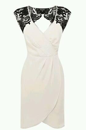 vestido com aplicação em renda. Preto e branco.