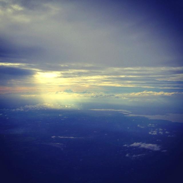 Sun through clouds(shot on the plane)