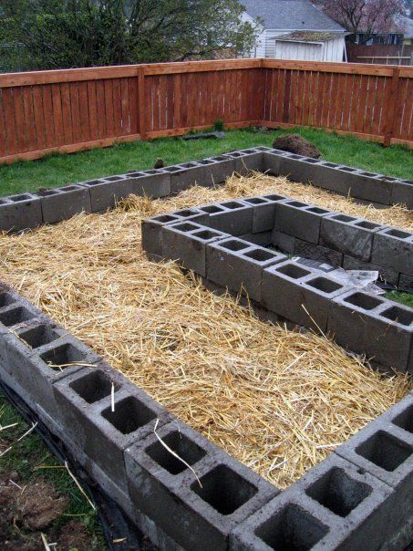 raised beds of concrete block, wattle fence facade, leaving tops open for annual/bulb plantings