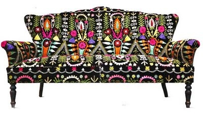 Couch with bombastic folkore print.