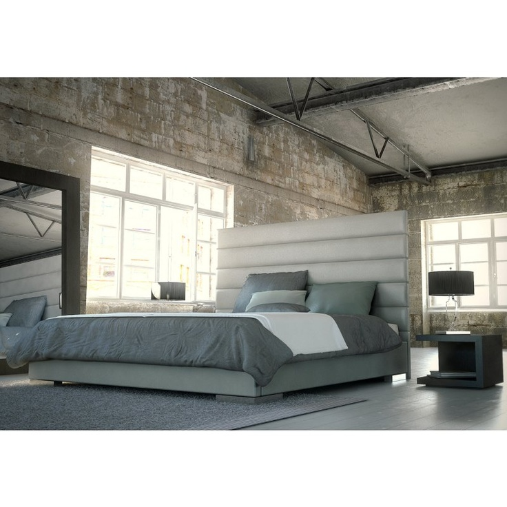 Prince Grey Platform Bed. Tufted headboard, the oversized mirror, exposed beams and pipes. It works.
