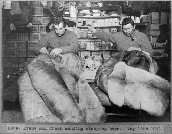 "Thomas Crean (on left) and Petty Officer Evans (on right) mending sleeping bags. Taken by Herbert George Ponting on 16 May 1911 during British Antarctic (""Terra Nova"") Expedition (1910-1913). You can view more images from  the Kinsey albums  showing this ill fated http://natlib.govt.nz/items?i[collection_any_id]=100763i[-category]=Groups"