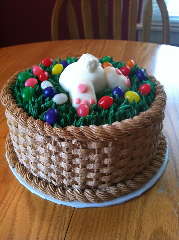 Bunny Butt Easter Basket - This was my first attempt at a basket. Triple layer strawberry cake with buttercream basket and grass, fondant bunny, and real jelly beans. My 11 year old son loves the bunny butt.