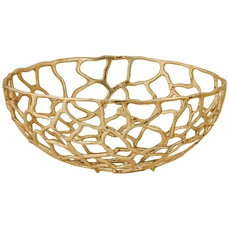 This transitional large freeform bowl features an abstract, golden cage-like design.