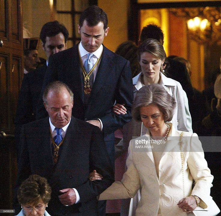 Spain's King Juan Carlos I and his wife Queen Sofia (bottom) arrive at a military parade to celebrate the opening of the Spanish Parliament eight legislature, followed by Prince Felipe and his fiancee Letizia Ortiz (top), 22 April 2004 in the Spanish city of Madrid. Expressing 'hope and optimism' for his country's future, King Juan Carlos formally opened the new Spanish parliament Thursday following March 14 elections which saw a Socialist, Jose Luis Rodriguez Zapatero, promise a new…
