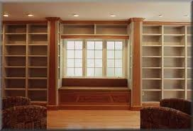 built in book shelves with window seat