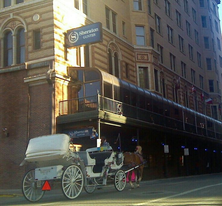 TOURISM VIA HORSE CARRIAGE...on street along West Side of historic Gunter Hotel downtown San Antonio TX...photo jrhenry jr 2014