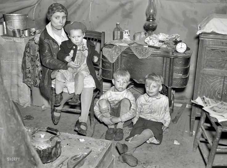"April 1937-Flood refugee family in tent at Tent City near Shawneetown, Illinois. ""Is that a toy motorcycle on the floor to the mother's right? The youngest has a doll. And mother saved her sewing machine (a major investment and a tool for further savings by making things). Today, after the family members, what would we save? Photo albums? Computer disks with photos?""  Photo by Russell Lee"