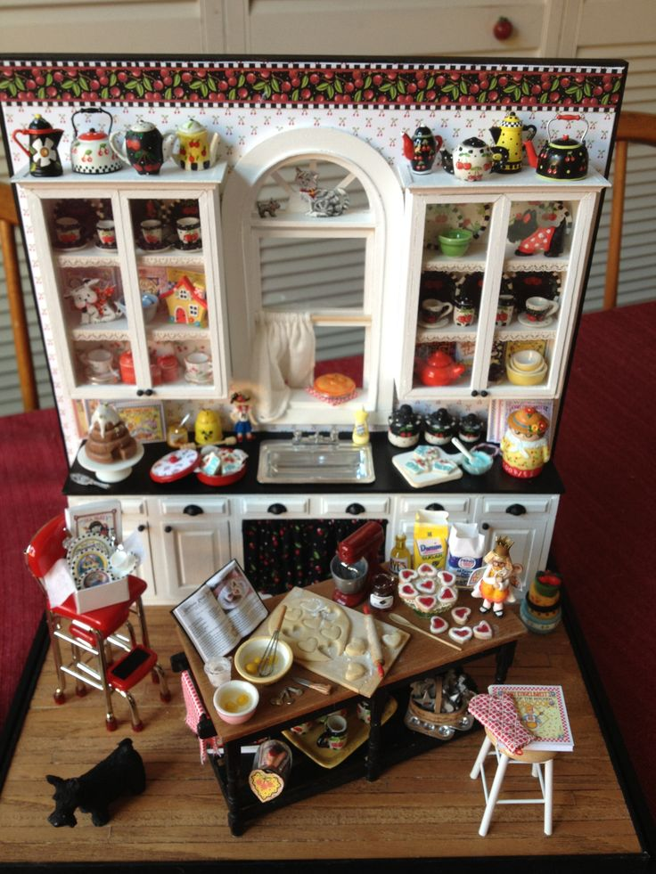 Mary Engelbreit dollhouse miniature - I love this.  Really want that red chair/step stool.  Have one in full size.