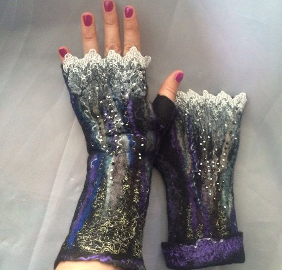 Fingerless gloves made out of super fine merino wool , silk , lace , netting . Beaded . Spoil yourself or get those for a friend ..very soft , cozy