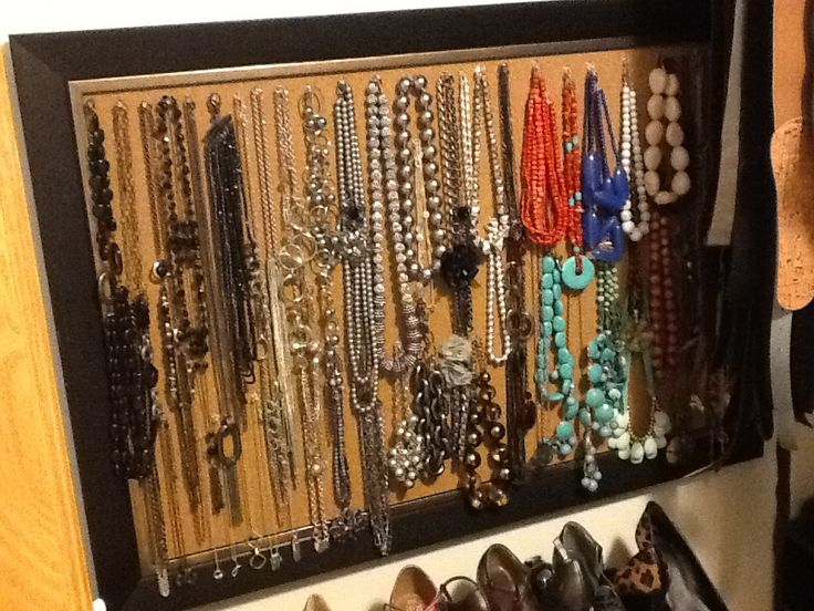 DIY necklace organizer! Use a framed cork board, push pins and hang your necklaces. I hung this in my walk-in closet!