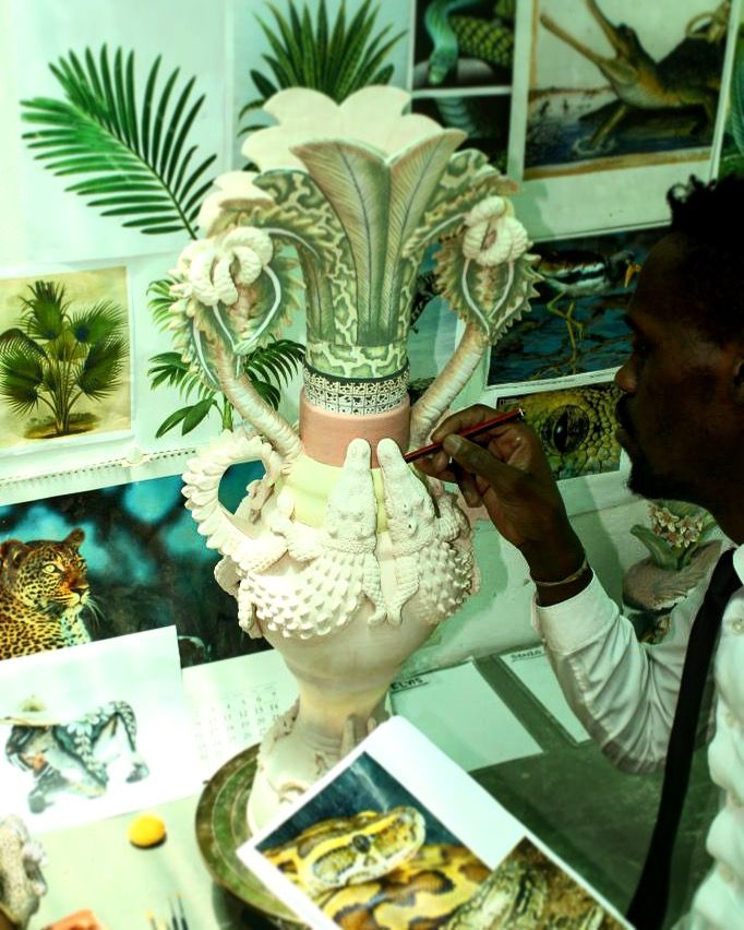 Senzo Blade thoroughly enjoying painting this exquisite Zambezi crocodile inspired vase in anticipation for our February Exhibition in Cape Town.