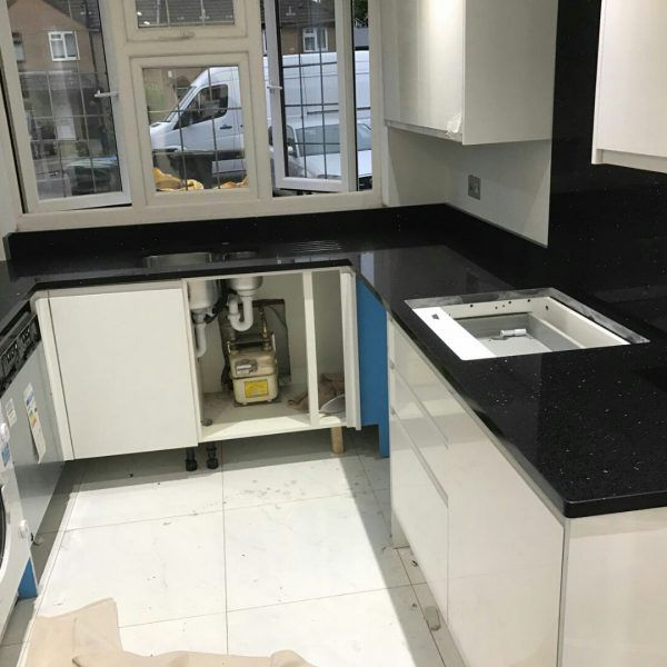 The popular Nero Stella was installed in to this modern kitchen. It works perfectly with the white gloss kitchen giving off a monochrome feel.