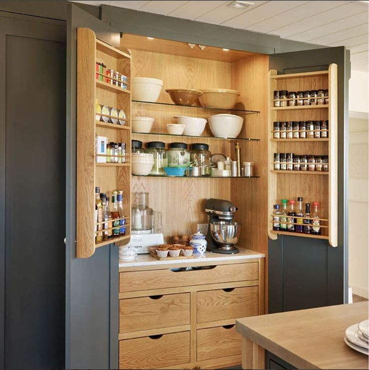 Conceal & Reveal - changing your mindset inside your cupboards with a custom larder by Moneyhill Interiors.Looks good with the doors open as well as shut!