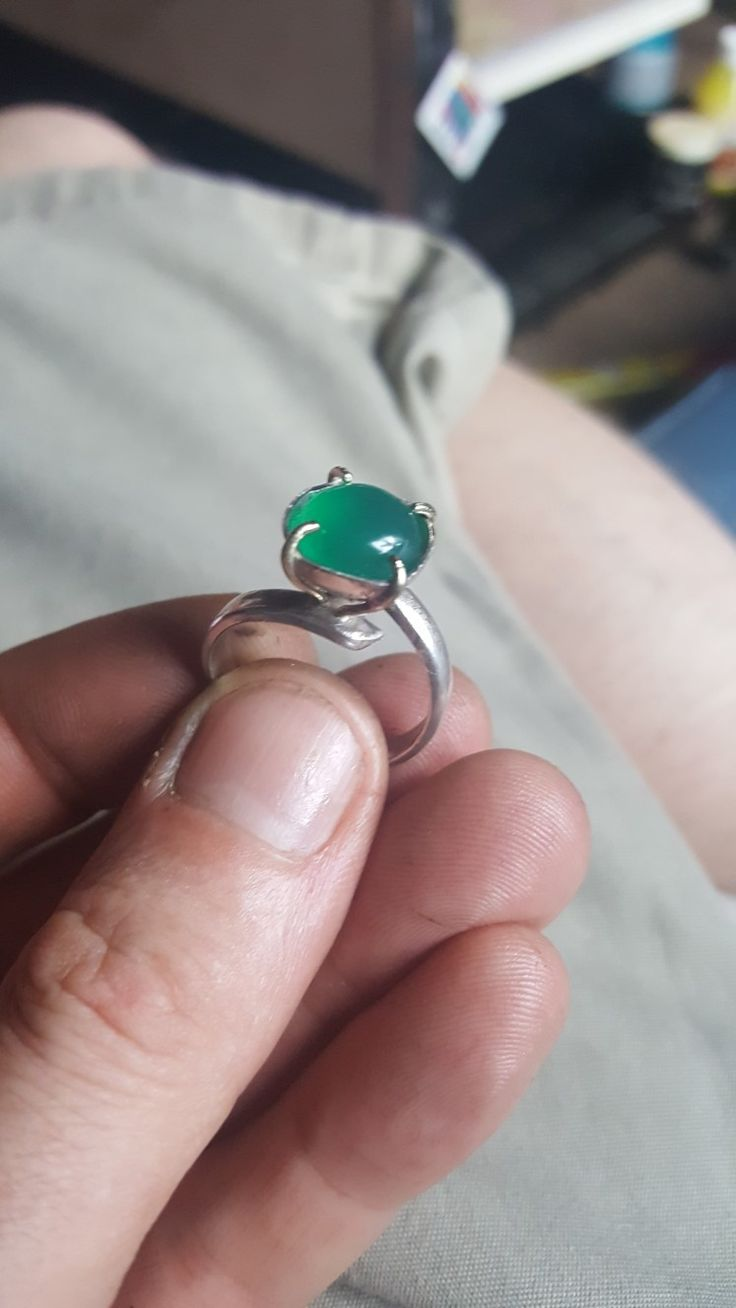 handmade silver ring with 4 prong cupped setting with onyx stone